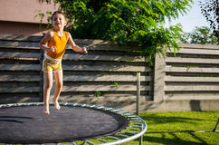 Happy boy on a trampoline Royalty Free Stock Photos