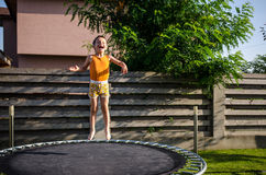 Happy boy on a trampoline Stock Photos