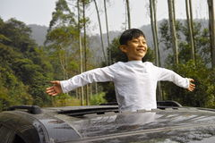 Happy boy travel in car Stock Photos