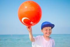 Happy boy on turkish sea resort beach royalty free stock photo