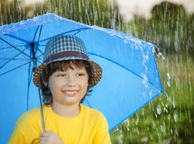 Happy boy with umbrella outdoors, child with an umbrella walks i Royalty Free Stock Photography