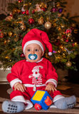 Happy boy under Christmas tree Stock Image