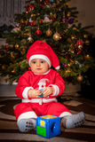 Happy boy under Christmas tree Royalty Free Stock Image