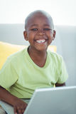 Happy boy using a laptop Royalty Free Stock Photography