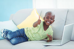 Happy boy using a laptop Royalty Free Stock Photos