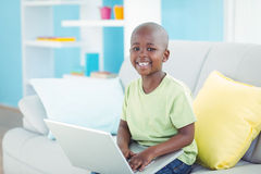 Happy boy using a laptop Royalty Free Stock Images