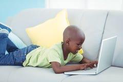 Happy boy using a laptop Stock Image