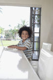 Happy Boy Using Laptop At Dining Table Royalty Free Stock Photography