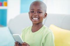 Happy boy using a smartphone Royalty Free Stock Photo