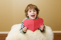 Happy boy with a valentine Stock Image