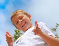 Happy boy w/ pointing fingers Stock Photo