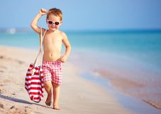 Happy boy walking the summer beach Royalty Free Stock Images