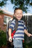 A happy boy walking to school Stock Photo