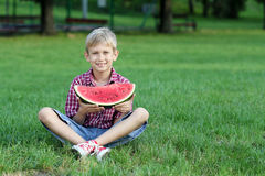 Happy boy with watermelon Stock Photo