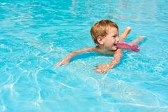Happy boy in waterpool Stock Photography