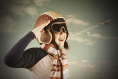 Happy boy wearing an aviator helmet Royalty Free Stock Images
