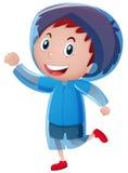 Happy boy wearing blue raincoat Royalty Free Stock Photo