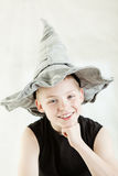 Happy boy wearing gray pointed hat Stock Image