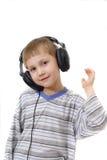 Happy boy wearing headphones. Portrait of a happy young boy wearing black headphones Stock Photos