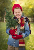Happy Boy Wearing Holiday Clothing Holding Small Christmas Tree Stock Photos