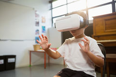 Happy boy wearing virtual reality simulator while standing at home Stock Photography