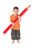 Happy boy whit large pencil Stock Image