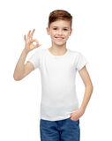 Happy boy in white t-shirt showing ok hand sign Stock Images