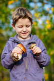 Happy boy with wild mushrooms Royalty Free Stock Photography