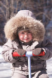 Happy boy in winter clothes Royalty Free Stock Images
