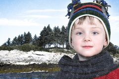 Happy Boy in Winter Clothes at Lake Park in Snow Royalty Free Stock Photo