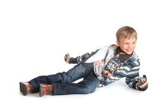 Happy boy in winter clothing. Cute, happy young boy in winter clothing royalty free stock photography