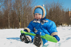 Happy boy in winter outdoors Stock Photos