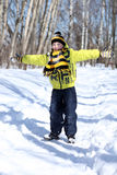 Happy boy in a winter park. Little boy in a winter park royalty free stock photography