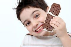 Happy Boy With Ice Cream Sandwich Stock Photos