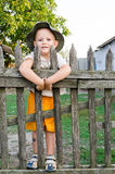 Happy boy on a wooden fence Royalty Free Stock Photo