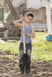 Happy boy working with shovel in garden Stock Photos
