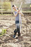 Happy boy working with shovel in garden Royalty Free Stock Photography
