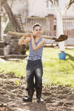 Happy boy working with shovel in garden Stock Photography