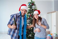 The happy boyfriend and girlfriend drinking champagne on christmas Royalty Free Stock Images
