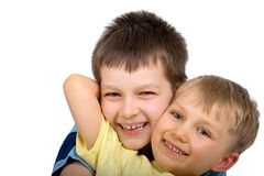 Happy Boys. Portrait of two happy brothers playfully embracing.  Isolated on white background Stock Photography