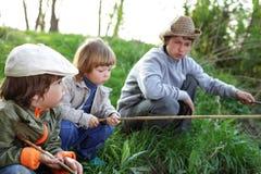 Happy boys  fishing Royalty Free Stock Image