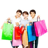 Happy boys with gifts. Kids carrying colorful shopping bags with Christmas presents isolated over white background, holidays Stock Photos