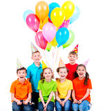 Happy boys and girls with colored balloons. Stock Images