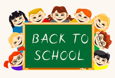 Happy boys and girls near school board Stock Images
