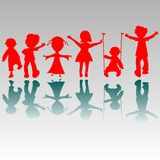 Happy boys and girls silhouettes Royalty Free Stock Images
