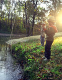 Happy boys go fishing on the river Royalty Free Stock Photography