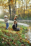 Happy boys go fishing on the river Royalty Free Stock Photos