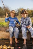 Happy boys go fishing on the river, Two children of the fisher w Stock Photos
