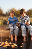 Happy boys go fishing on the river, Two children of the fisher w Stock Image