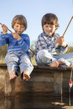 Happy boys go fishing on the river , Two children of   fisherm Stock Photo